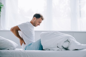 What type of mattress should I choose to get relief from back pain?